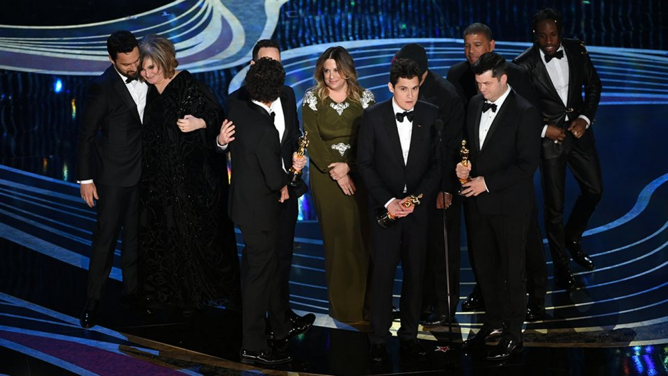 crew of spider man into the spider verse accepts the animated feature film award during the 91st annual academy awards oscars 2019 getty h 2019